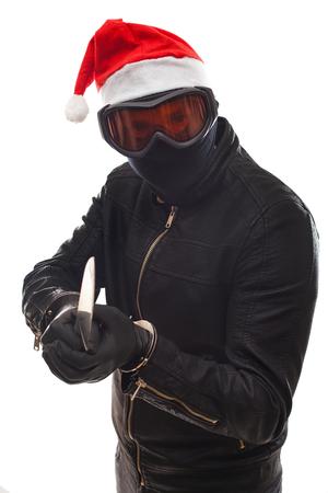 Gefährlicher Einbrecher kleidete in der schwarzen , die eine Maske auf Kopf - lokalisiertem Hintergrund trägt Standard-Bild - 88290788