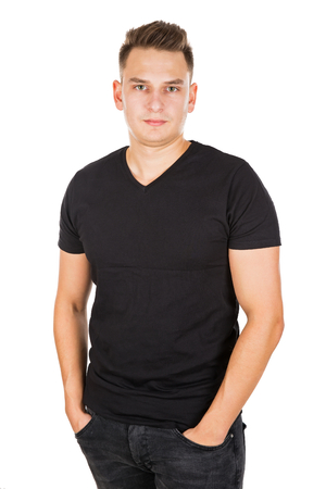 Handsome young man looking at the camera on isolated background