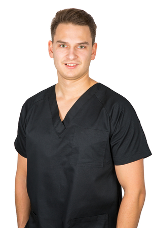 Picture of confident young male dentist posing in black uniform on isolated background Foto de archivo
