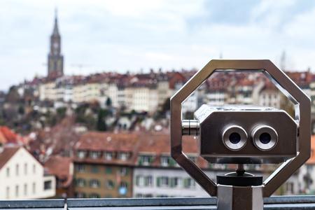 Panoramic view of Bern old town and binoculars, Switzerland