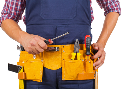 Close up picture of handyman's yellow tool belt - holding a screwdriver on isolated background 版權商用圖片