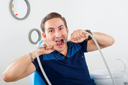 Crazy patient sitting in a dental chair