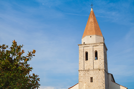 Roman-catholic church in Krk old town, Croatia - venetian style ancient construction 写真素材