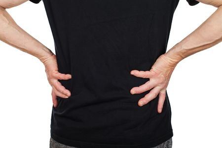 Elderly man suffering from low back pain