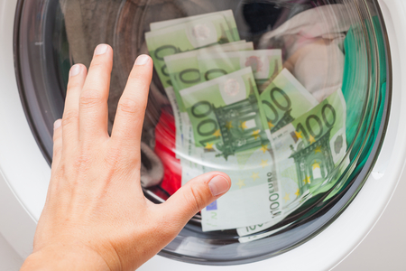 Lot of money stuck in the washing machine, man trying to open the door