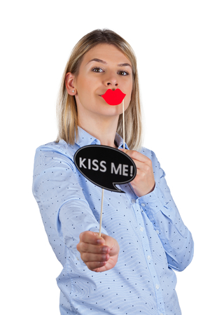 Attractive young woman holding photo booth accessories - Kiss me, baby - concept on isolated Archivio Fotografico
