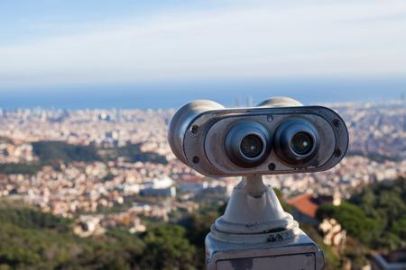 Panorama of Barcelona and binoculars - from Tibidabo mountain - beautifu bright sky