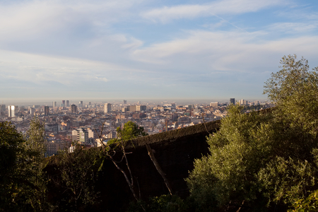 Morning panorama of Barcelona taken from Park Güell - rooftops, historical buildings, beautiful sunny weather