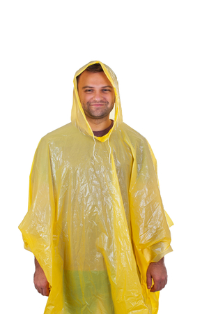 Picture of a caucasian young man wearing a yellow raincoat, posing on isolated background Imagens