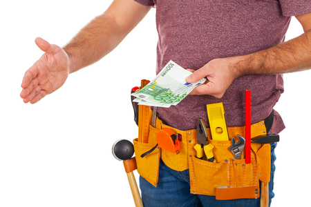 Close up picture of a repairman with toolbelt on isolated background receive money or salary Stockfoto