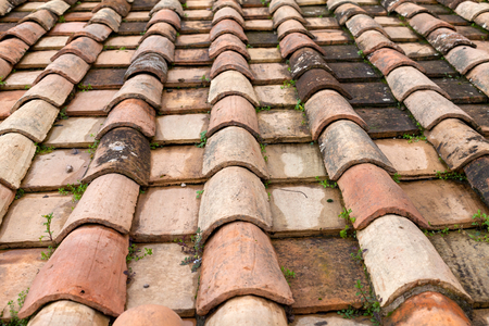 Close up picture of an old historic house tiled roof - waterproof, traditional rooftop