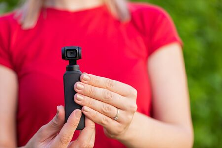 Close up picture of osmo camera in female hands