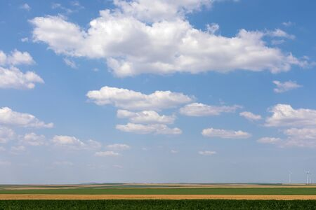 Beautiful scenic picture of the blue sky and white, fluffy clouds over the horizon 스톡 콘텐츠