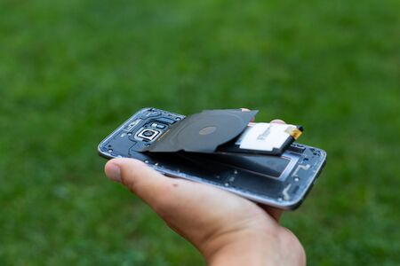 Close up of a damaged smartphone with expanded lithium ion battery Standard-Bild