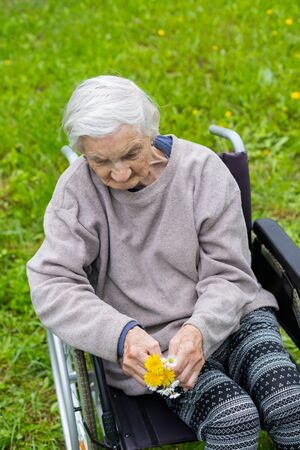 Aged woman with dementia sitting in a wheelchair