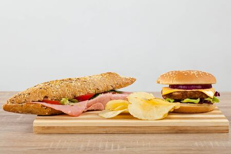 Close-up picture of delicious sandwiches: cheeseburger, big mac and panini with ham