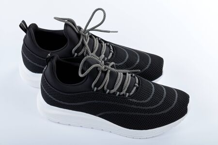 Close up picture of comfortable mens sneakers on wooden background. New, fashionable, casual, sport footwear Stock fotó