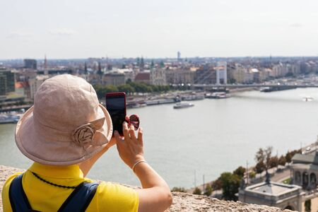 Picture of female tourists taking pictures in Budapest, Hungary