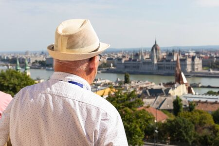 Photo of an old man visiting Budapest