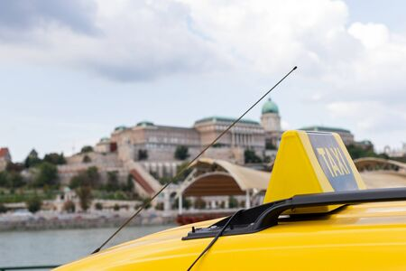 Yellow taxi cabs waiting for a passenger in Budapest