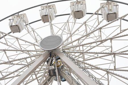 Photo of a big white ferris wheel in Sibiu, Romania