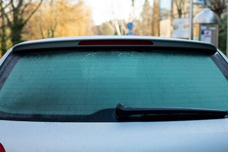 Frozen car parked on the street on December
