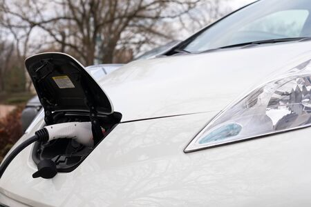 Electric car charging on parking lot in Gyula, Hungary