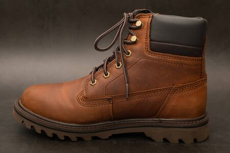 Brand new brown winter boots on gray background Standard-Bild