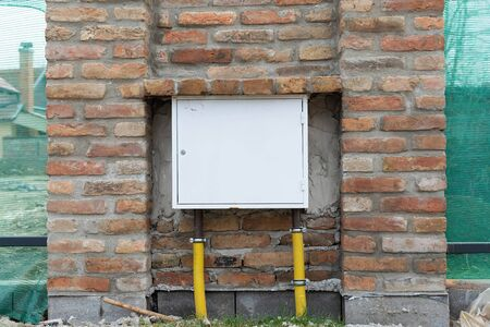 Picture of a gas meter installation on a house wall