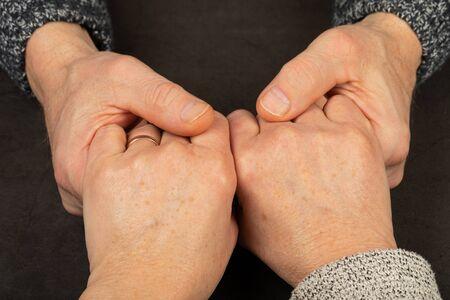 Caregiver holding elderly patients hand at home Stock fotó