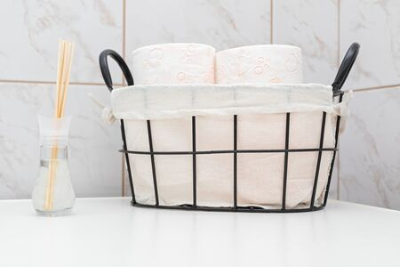 Soft toilet paper rolls in a vintage basket