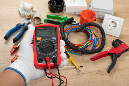 Tools for electrician needs: shocket multimeter, voltage testers, wire strippers, pliers,