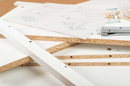 Close up picture of carpenter tools for furniture assembling at home