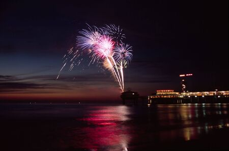 accelerate: Fireworks at the beach during sunset Stock Photo