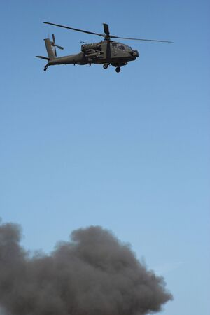 superiority: Apache helicopter in flight in a warzone Stock Photo