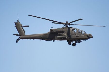 united states air force: Apache helicopter  in flight Stock Photo