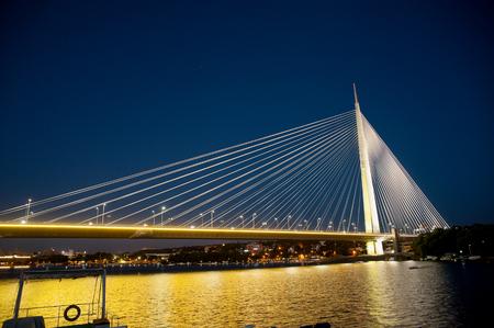 Abstract image - Suspension Bridge night lights. Dusk Skyline Stock Photo