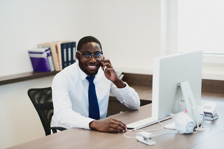 swanky: Young African American man with glasses in office