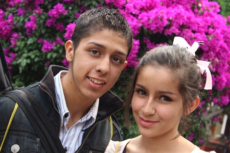 A young couple between flowers Фото со стока