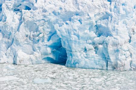 Deep blue cave in a glacier