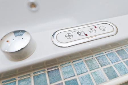 Control panel on bathtub Фото со стока