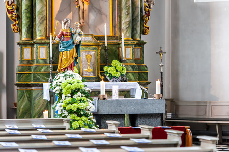 Chruch interior with candles and flowers