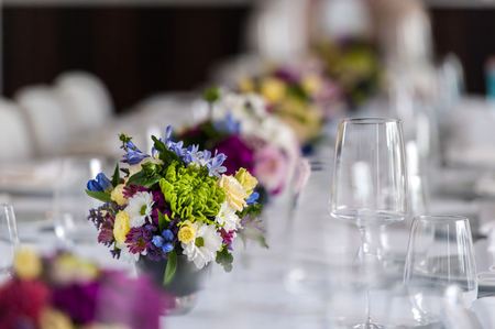 Party table with glasses and flowers