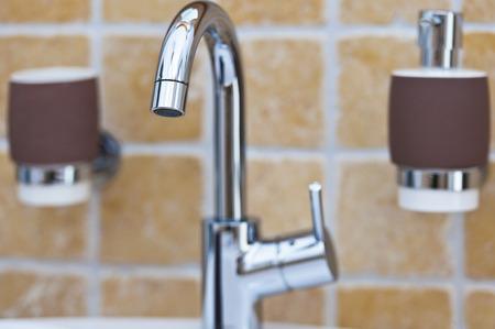 Chrome mixer tap in bathroom