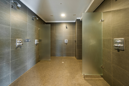 Clean and modern shower room in fitness studio