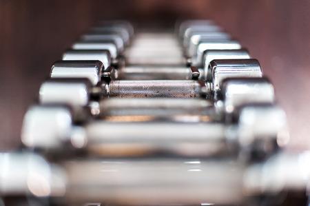 Multiple chrome dumbbells in fitness center