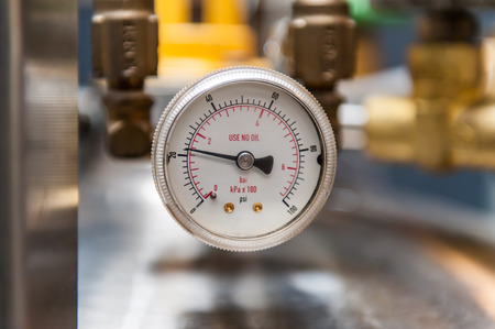Pressure gauge isolated on a blurred background Фото со стока
