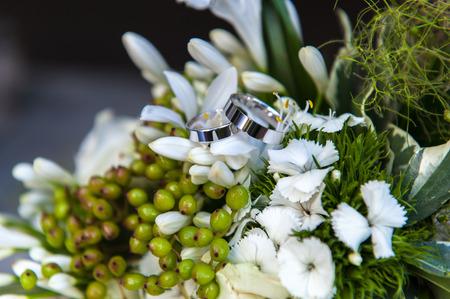 Weddings rings on flower bouquet