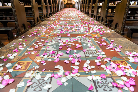 Flower petals on a church ground