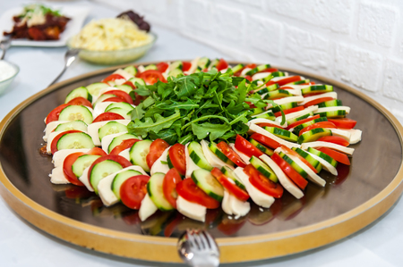 Italian starter meal on wooden plate
